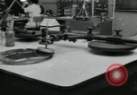 Image of PrecisionGrinding of glass lenses Anaheim California USA, 1960, second 22 stock footage video 65675022147
