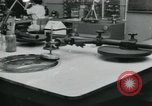 Image of PrecisionGrinding of glass lenses Anaheim California USA, 1960, second 24 stock footage video 65675022147