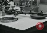 Image of PrecisionGrinding of glass lenses Anaheim California USA, 1960, second 26 stock footage video 65675022147
