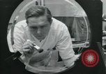 Image of PrecisionGrinding of glass lenses Anaheim California USA, 1960, second 36 stock footage video 65675022147