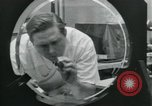Image of PrecisionGrinding of glass lenses Anaheim California USA, 1960, second 37 stock footage video 65675022147