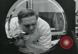 Image of PrecisionGrinding of glass lenses Anaheim California USA, 1960, second 40 stock footage video 65675022147