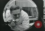 Image of PrecisionGrinding of glass lenses Anaheim California USA, 1960, second 41 stock footage video 65675022147