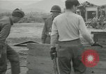 Image of US troops in makeshift shelters during Korean War South Korea, 1951, second 26 stock footage video 65675022170