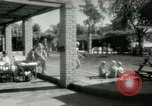 Image of Military Assistance Advisory Group officers and wives Baghdad Iraq, 1956, second 22 stock footage video 65675022186