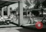 Image of Military Assistance Advisory Group officers and wives Baghdad Iraq, 1956, second 23 stock footage video 65675022186