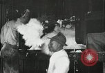 Image of Baling the lint of cotton New Orleans Louisiana USA, 1919, second 13 stock footage video 65675022212