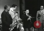 Image of Japanese instrumentalists join the Goodman band Japan, 1957, second 60 stock footage video 65675022215