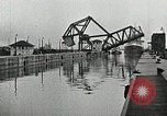 Image of Ship entering the inner harbor canal New Orleans Louisiana USA, 1929, second 32 stock footage video 65675022220