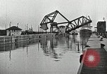 Image of Ship entering the inner harbor canal New Orleans Louisiana USA, 1929, second 33 stock footage video 65675022220