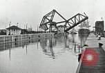 Image of Ship entering the inner harbor canal New Orleans Louisiana USA, 1929, second 36 stock footage video 65675022220