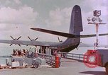 Image of US Aircraft JRM-1 removing casualties and taking off Pearl Harbor Hawaii USA, 1946, second 20 stock footage video 65675022271