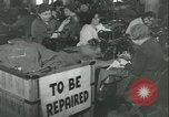Image of GI's clothing salvaged Reims France, 1947, second 2 stock footage video 65675022354