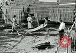 Image of GI's clothing salvaged Reims France, 1947, second 57 stock footage video 65675022354