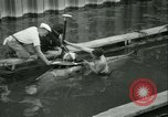 Image of Byron Connett in small submarine Michigan City Indiana USA, 1938, second 18 stock footage video 65675022389