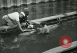 Image of Byron Connett in small submarine Michigan City Indiana USA, 1938, second 19 stock footage video 65675022389