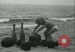Image of Baby Larry Simms lifting weights Venice Beach Los Angeles California USA, 1936, second 15 stock footage video 65675022417