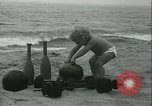 Image of Baby Larry Simms lifting weights Venice Beach Los Angeles California USA, 1936, second 16 stock footage video 65675022417