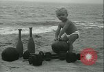 Image of Baby Larry Simms lifting weights Venice Beach Los Angeles California USA, 1936, second 17 stock footage video 65675022417