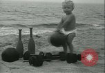 Image of Baby Larry Simms lifting weights Venice Beach Los Angeles California USA, 1936, second 18 stock footage video 65675022417