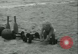 Image of Baby Larry Simms lifting weights Venice Beach Los Angeles California USA, 1936, second 30 stock footage video 65675022417