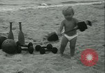 Image of Baby Larry Simms lifting weights Venice Beach Los Angeles California USA, 1936, second 31 stock footage video 65675022417