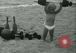 Image of Baby Larry Simms lifting weights Venice Beach Los Angeles California USA, 1936, second 32 stock footage video 65675022417