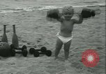 Image of Baby Larry Simms lifting weights Venice Beach Los Angeles California USA, 1936, second 33 stock footage video 65675022417