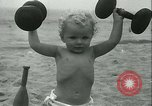 Image of Baby Larry Simms lifting weights Venice Beach Los Angeles California USA, 1936, second 49 stock footage video 65675022417