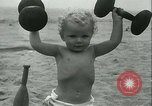 Image of Baby Larry Simms lifting weights Venice Beach Los Angeles California USA, 1936, second 50 stock footage video 65675022417