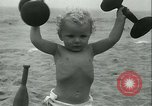 Image of Baby Larry Simms lifting weights Venice Beach Los Angeles California USA, 1936, second 51 stock footage video 65675022417