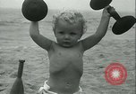 Image of Baby Larry Simms lifting weights Venice Beach Los Angeles California USA, 1936, second 52 stock footage video 65675022417
