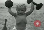 Image of Baby Larry Simms lifting weights Venice Beach Los Angeles California USA, 1936, second 53 stock footage video 65675022417