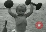 Image of Baby Larry Simms lifting weights Venice Beach Los Angeles California USA, 1936, second 54 stock footage video 65675022417