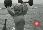Image of Baby Larry Simms lifting weights Venice Beach Los Angeles California USA, 1936, second 55 stock footage video 65675022417