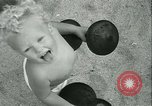 Image of Baby Larry Simms lifting weights Venice Beach Los Angeles California USA, 1936, second 56 stock footage video 65675022417