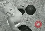 Image of Baby Larry Simms lifting weights Venice Beach Los Angeles California USA, 1936, second 57 stock footage video 65675022417