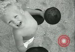 Image of Baby Larry Simms lifting weights Venice Beach Los Angeles California USA, 1936, second 58 stock footage video 65675022417
