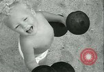 Image of Baby Larry Simms lifting weights Venice Beach Los Angeles California USA, 1936, second 59 stock footage video 65675022417