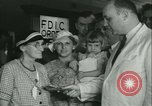 Image of FDIC pays depositors of failed Fon Du Lac Bank East Peoria Illinois USA, 1934, second 17 stock footage video 65675022427