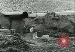 Image of Los Angeles Aqueduct Pipeline Jawbone Canyon, 1931, second 13 stock footage video 65675022470