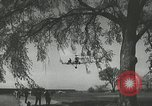 Image of Igor Sikorsky sets new record in Vought-Sikorsky VS-300 helicopter Stratford Connecticut USA, 1941, second 31 stock footage video 65675022494
