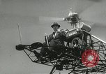 Image of Igor Sikorsky sets new record in Vought-Sikorsky VS-300 helicopter Stratford Connecticut USA, 1941, second 38 stock footage video 65675022494