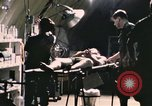 Image of wounded United States soldier Vietnam, 1969, second 7 stock footage video 65675022607