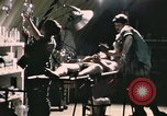 Image of wounded United States soldier Vietnam, 1969, second 8 stock footage video 65675022607