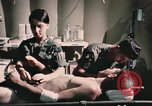 Image of wounded United States soldier Vietnam, 1969, second 47 stock footage video 65675022607