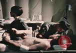 Image of wounded United States soldier Vietnam, 1969, second 48 stock footage video 65675022607