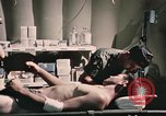 Image of wounded United States soldier Vietnam, 1969, second 53 stock footage video 65675022607
