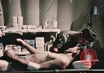 Image of wounded United States soldier Vietnam, 1969, second 55 stock footage video 65675022607