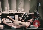 Image of wounded United States soldier Vietnam, 1969, second 57 stock footage video 65675022607
